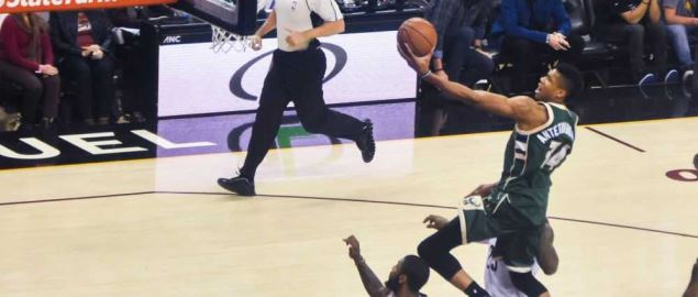 Milwaukee Bucks', Giannis Antetokoummpo leaps into the air for a layup.