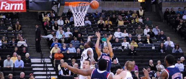 Richmond's Travis Mckie shooting a jumper in a 2011 home game.
