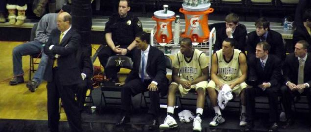 Kevin Stallings, with several assistants and players, during a Vanderbilt Commodores game.