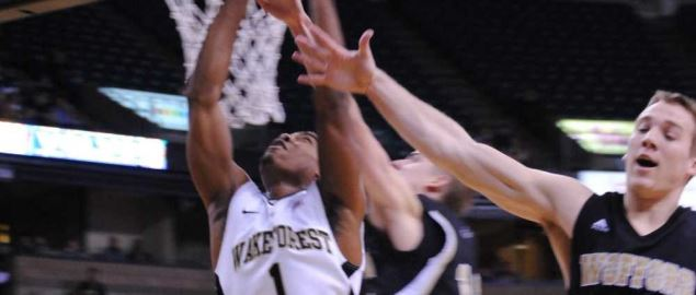 Wake Forest's Tony Chennault crashes the boards against Wofford.
